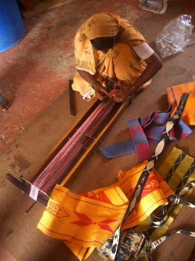 """Indian artisan weaves a cloth. Photo by Kathy Ross"" on Aid to Artisans Facebook page."