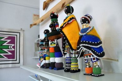 """Ndebele dols on show at the Africa Craft Trust (ATASA Trust) Exhibition in Johannesburg on June 10, 2010. Photo by Lauren Barkume"" on Aid to Artisans Facebook page."